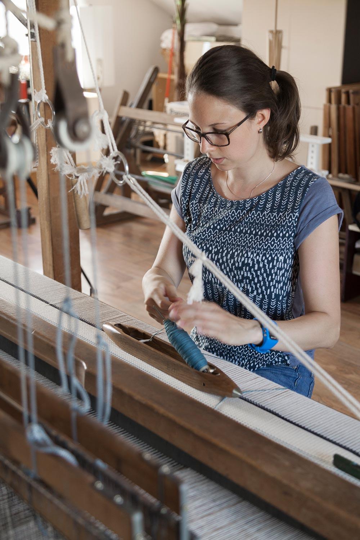 Krisztina Vandor in her studio while weaving