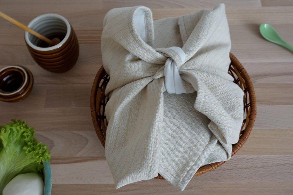 bread cloth in a basket covering a bread