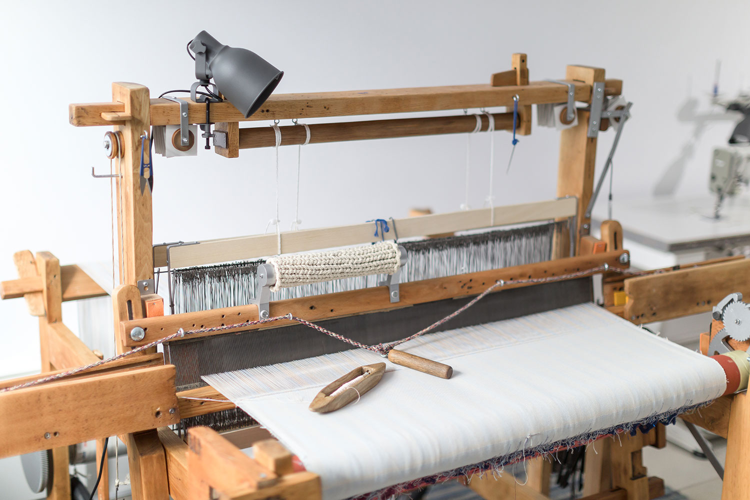 flying shuttle weaving loom with automatic cloth advance system called Jacq at Vandor Studio