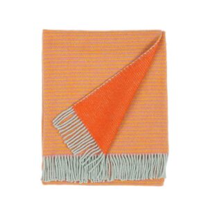 folded wool blanket in orange color with fringes