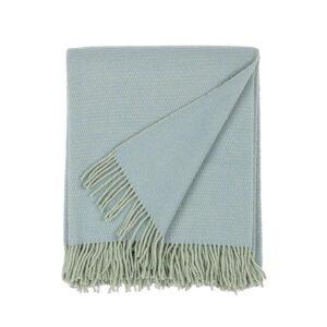 folded wool blanket in blue color with fringes