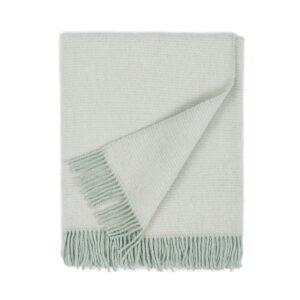 folded wool blanket in white color with fringes