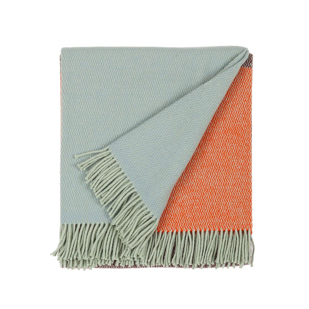 folded wool blanket in blue and orange color with fringes