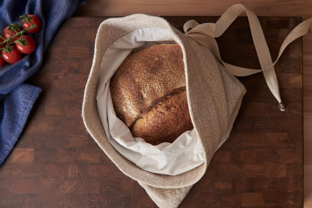 bread storage bag filled with a loaf