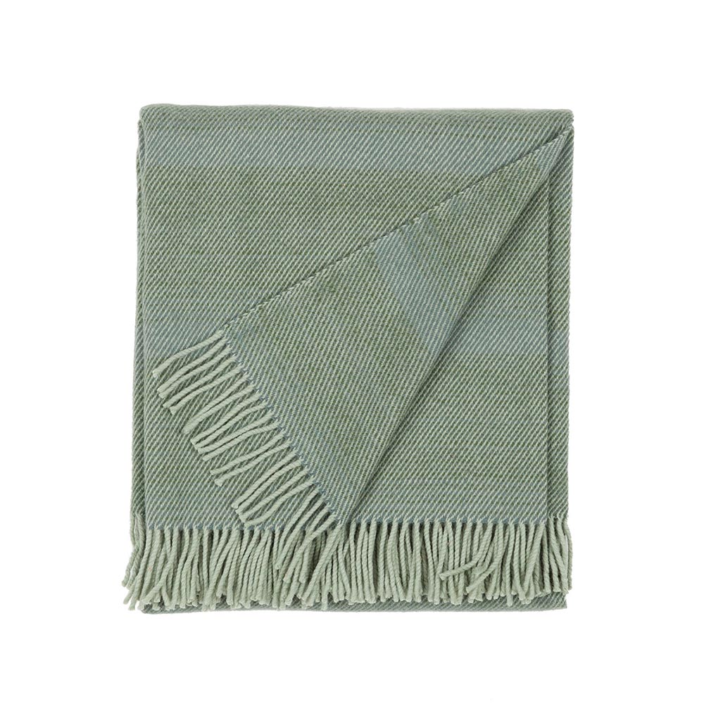 folded wool blanket in green color with fringes