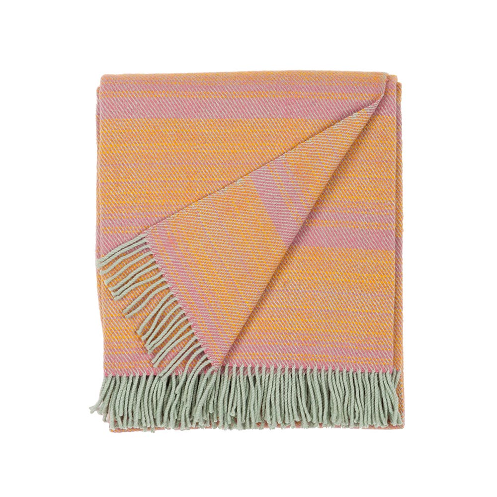 folded wool blanket in orange and rose color with fringes