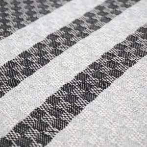 detail of a handwoven cushion with navy blue and grey stripes
