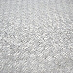 detail of a throw pillow in grey color