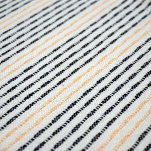 detail of a navy and peach striped cotton cushion
