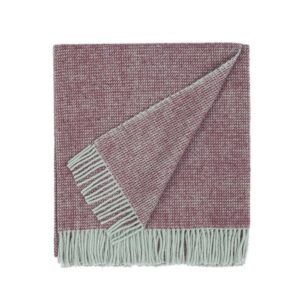 folded wool blanket in plum purple color with fringes