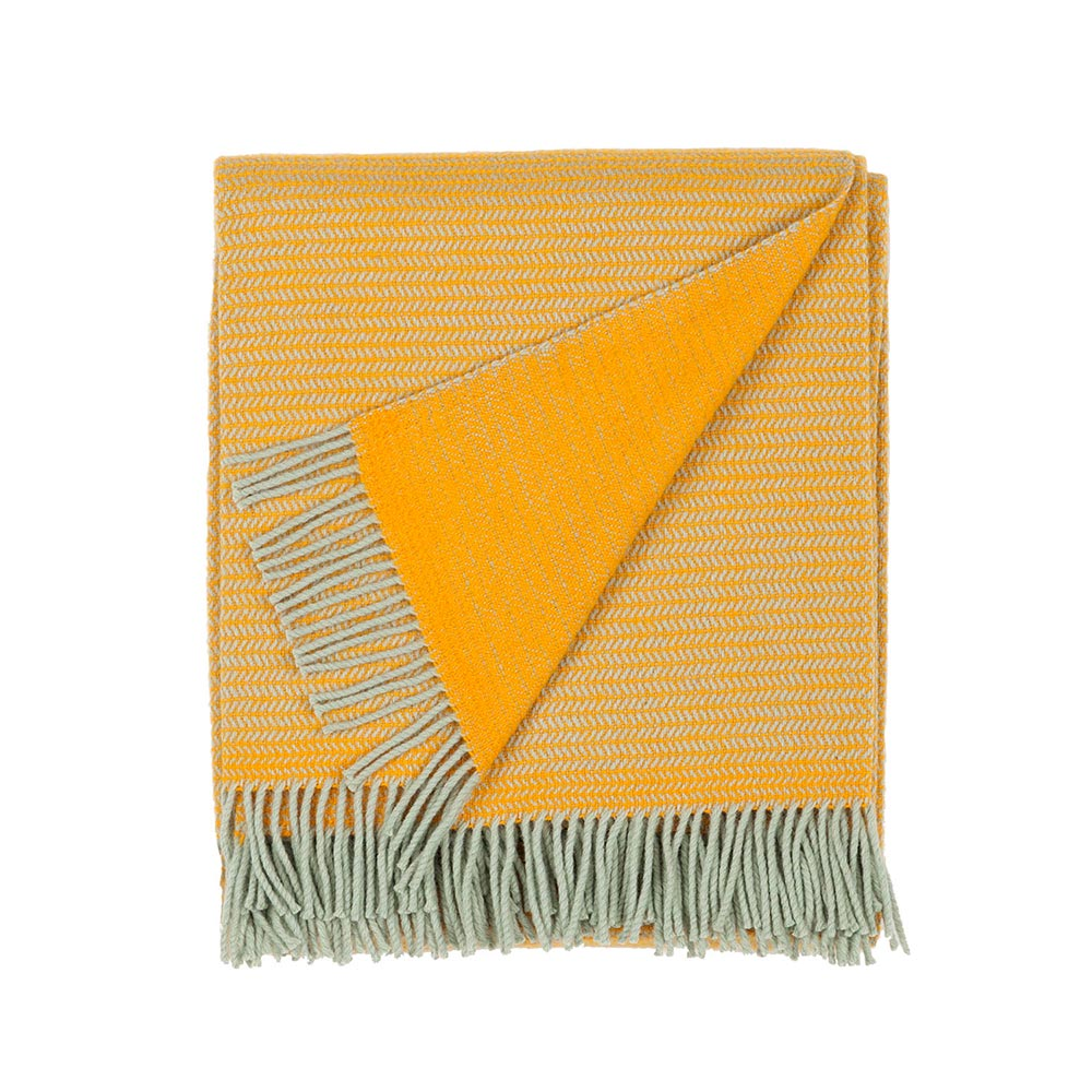 folded wool blanket in yellow color with fringes