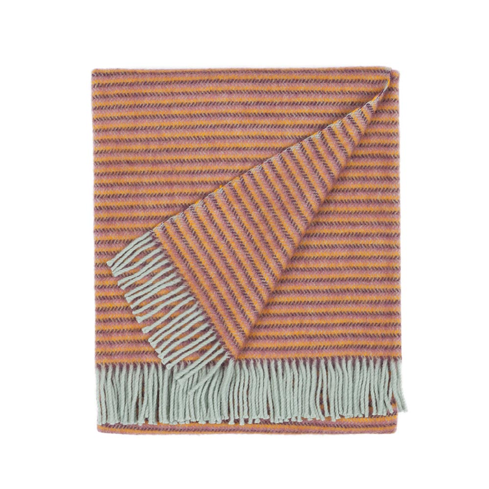 folded wool blanket with stripes and fringes